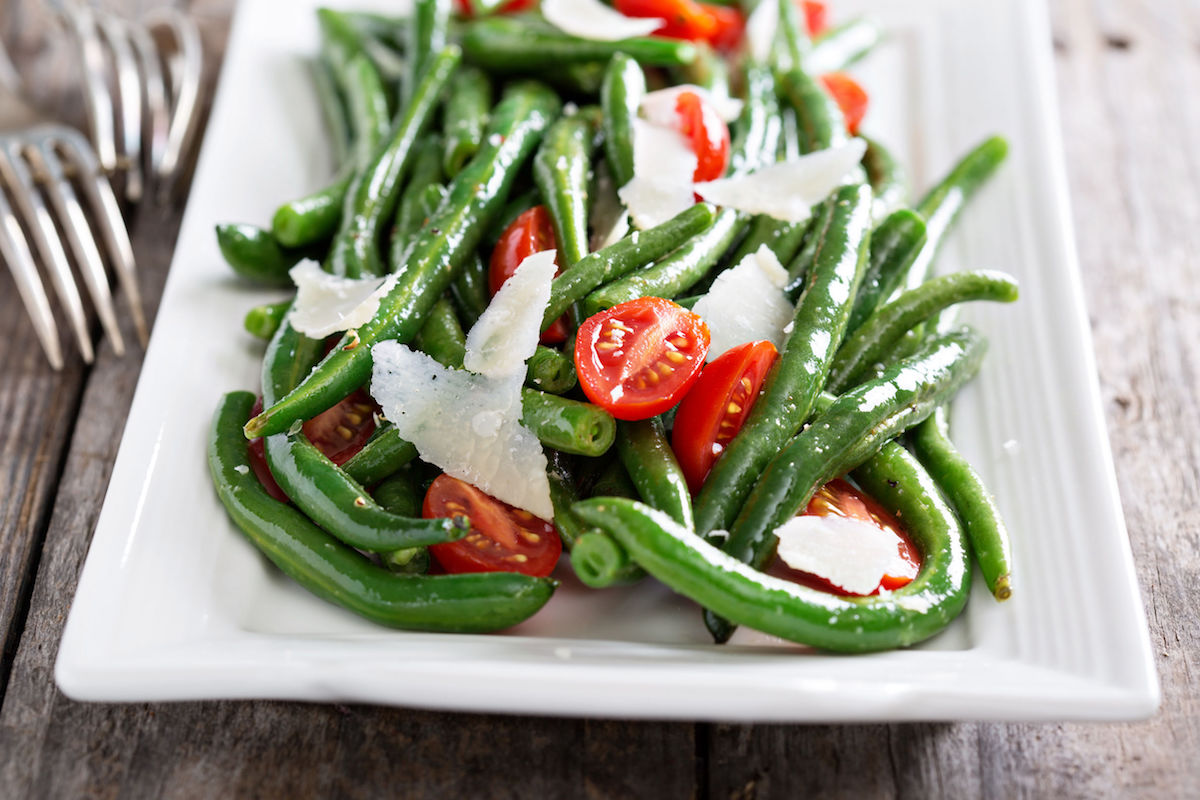 46291198 – warm salad with green beans, tomatoes and parmesan cheese