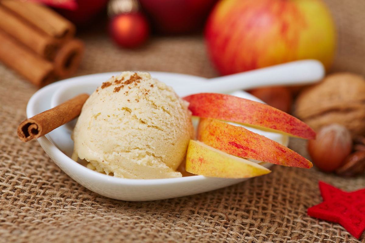 40815724 – cinnamon ice cream for christmas with apple and nuts for decoration
