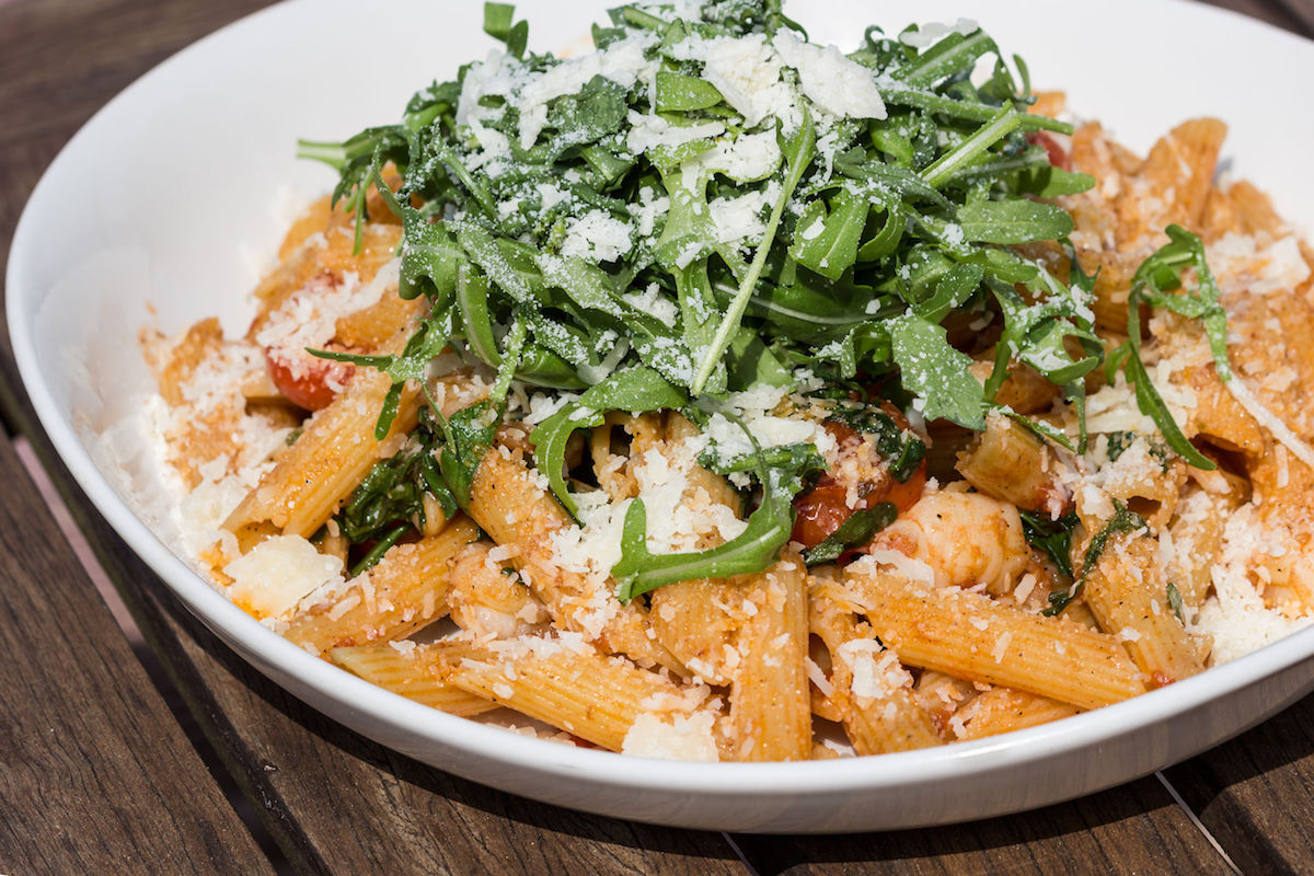 27706749 – rigatoni with spicy rucola salad, shrimp and parmesan cheese