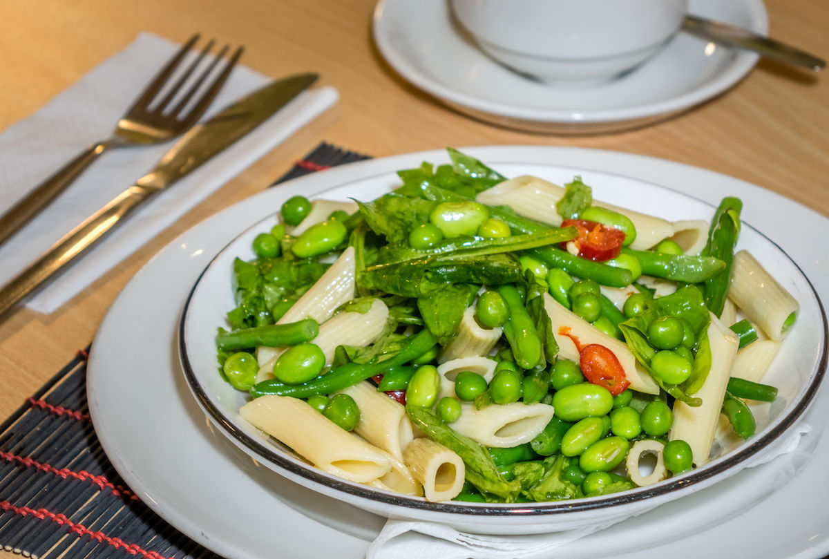 45089166 – close-up of freshly made green vegetables penne pasta