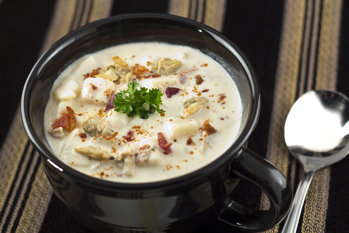 35487678 – creamy new england clam chowder garnished with parsley