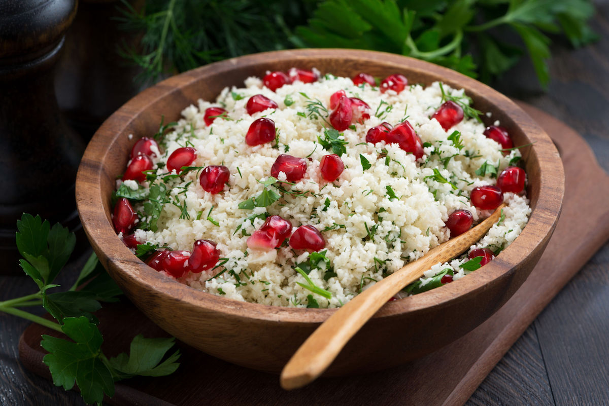 47255460 – cauliflower couscous with herbs and pomegranate, closeup, horizontal