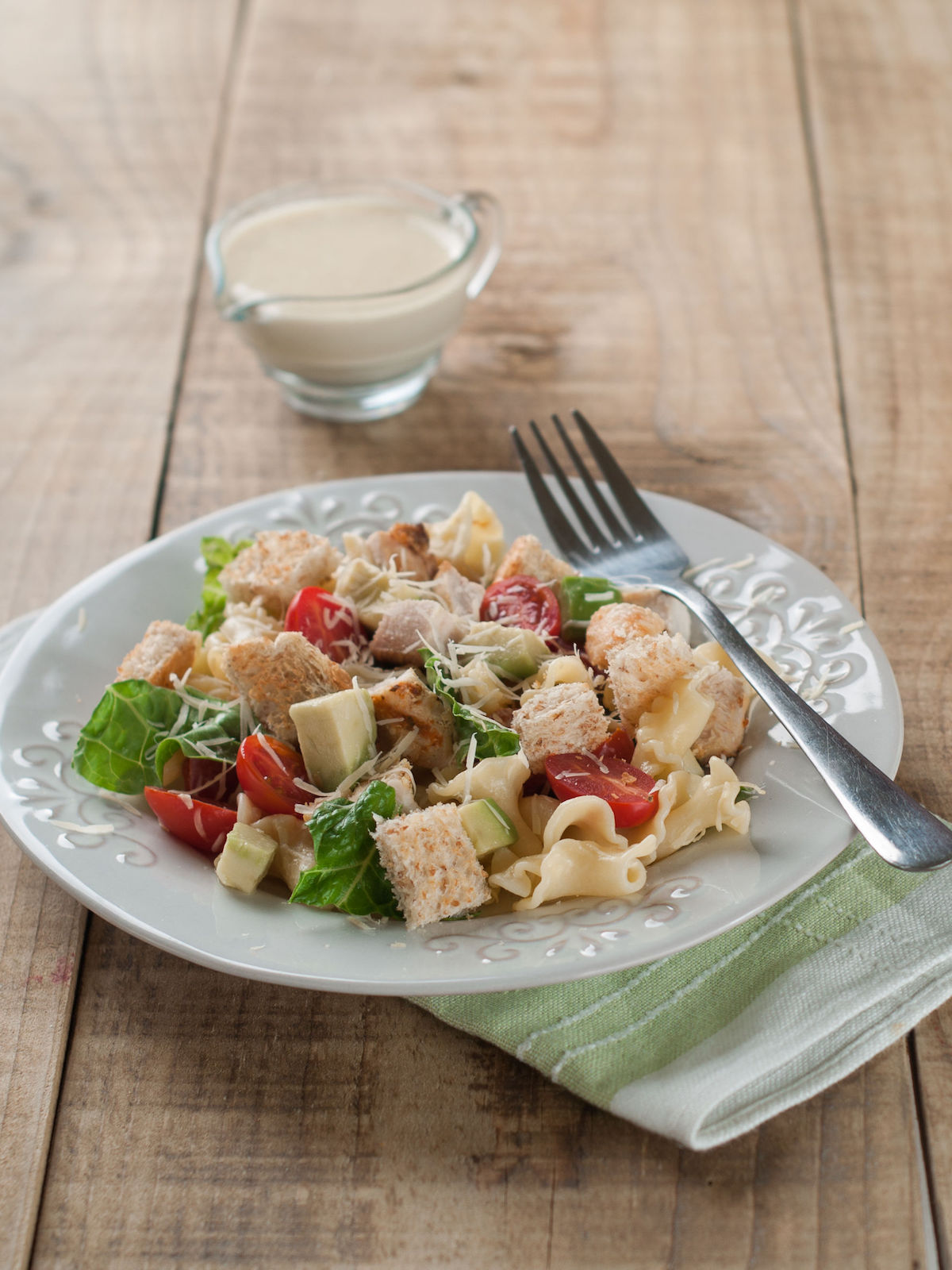 40974610 – pasta salad with chicken, tomato, cheese and sauce, selective focus